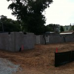 Front sidewalk view of Phase 2 foundations